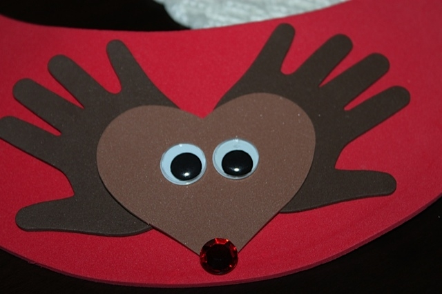 reindeer face made with a heart and hands for antlers